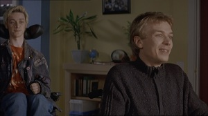 Screenshot from Inside I'm Dancing (2004) - Rory and Micheal looking outside the window
